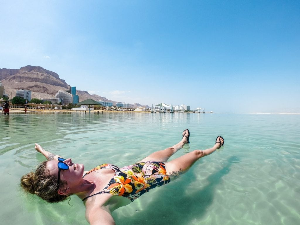 people floating in the dead sea