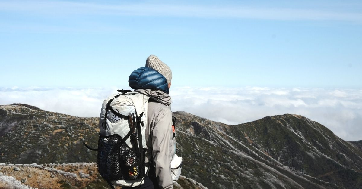 Attach sleeping bag to backpack